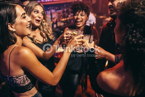 Group of friends partying in a nightclub : Stock Photo