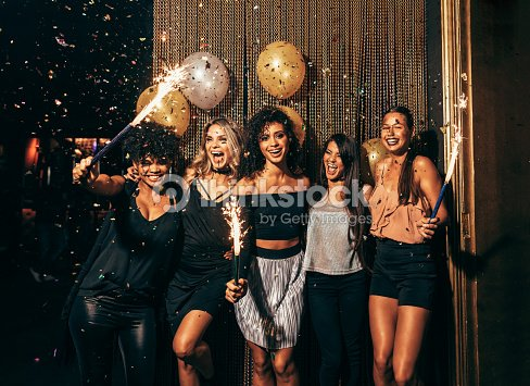 Group of friends partying in nightclub : Stock Photo