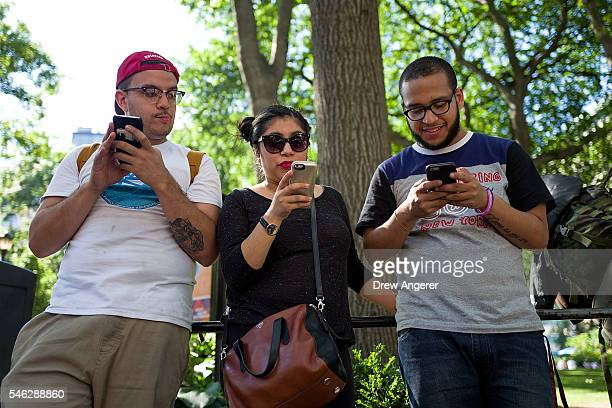 A group of friends play Pokemon Go on their smartphones at Union Square July 11 2016 in New York City The success of Nintendo's new smartphone game...