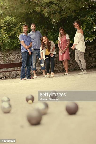 Group of friends playing boule in France