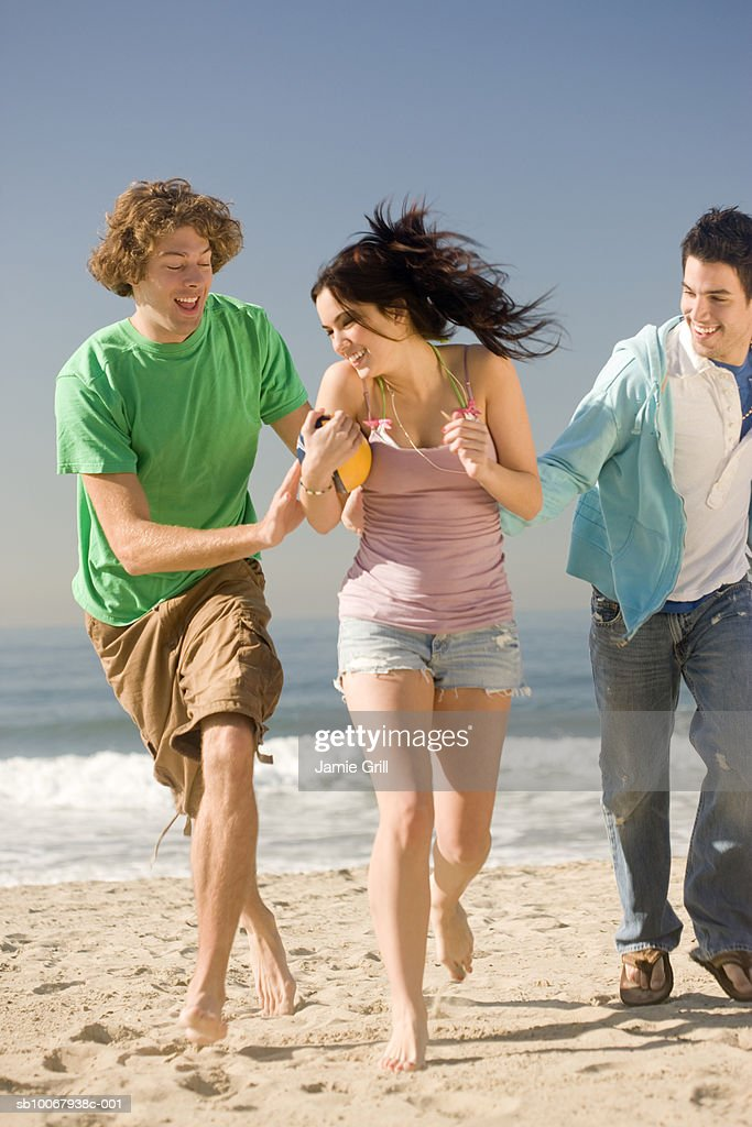 Group of friends playing football : Stock Photo