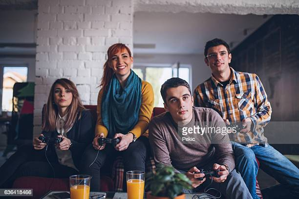 Group of friends playing hard with video games