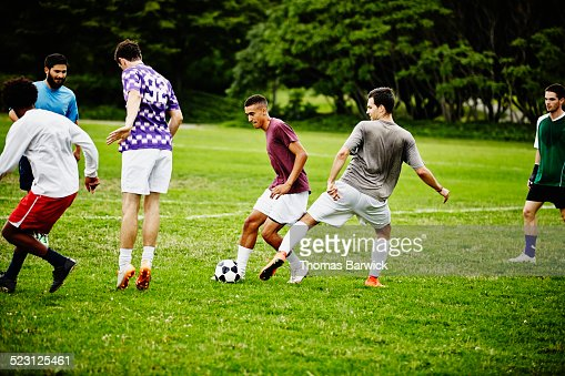 Group Of Friends Playing Pick Up Soccer Game Stock Photo ...
