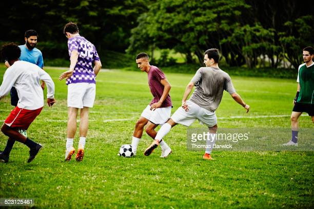 Group of friends playing pick up soccer game