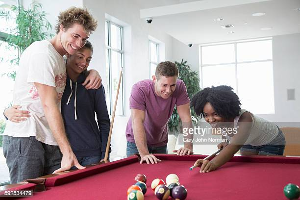 Group of friends playing pool.