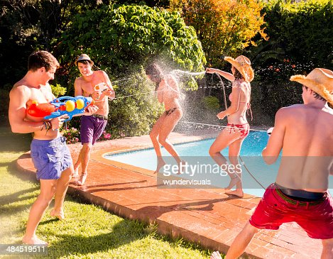 Group of friends playing with water guns
