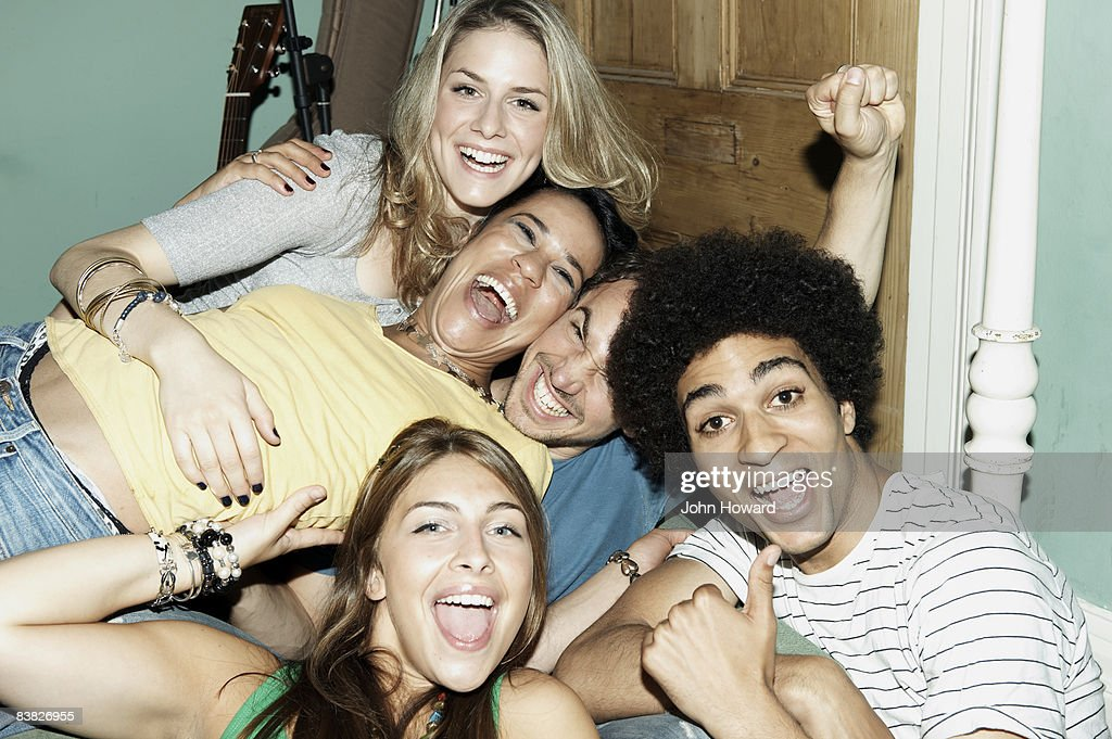 Group of friends posing for camera : Stock Photo