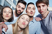 Group of friends pouting for a selfie