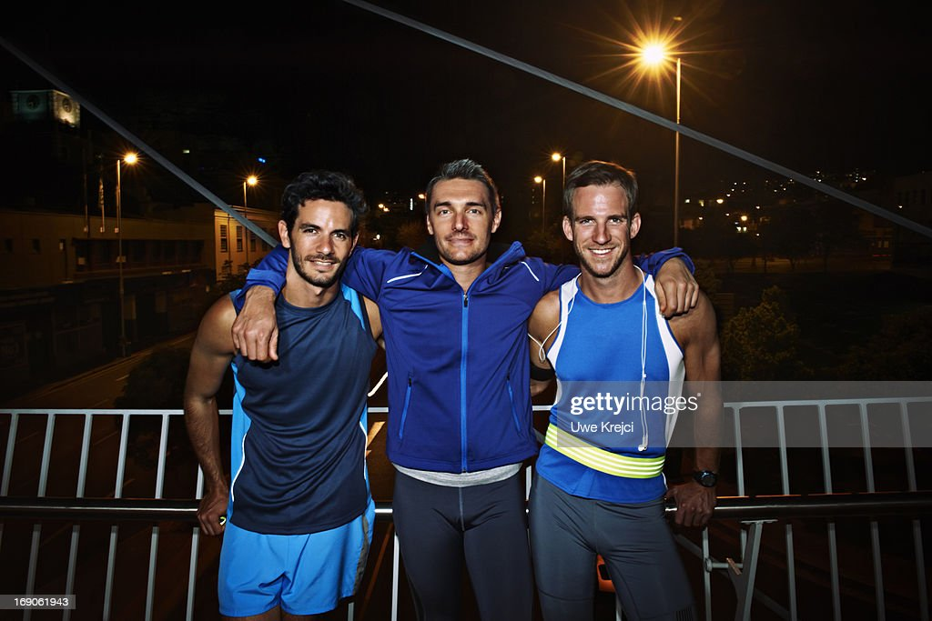 Group of friends relaxing after evening run : Stock Photo