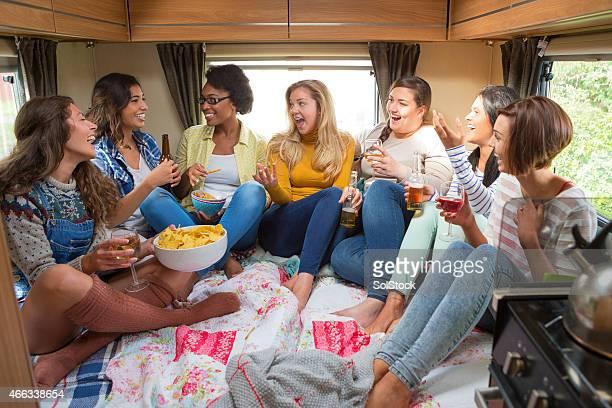Group of Friends Relaxing in Caravan
