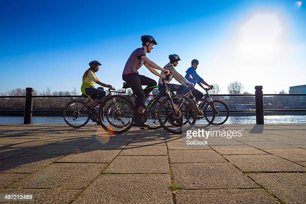 Group of Friends Riding Bikes