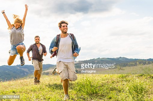 Group of friends running free