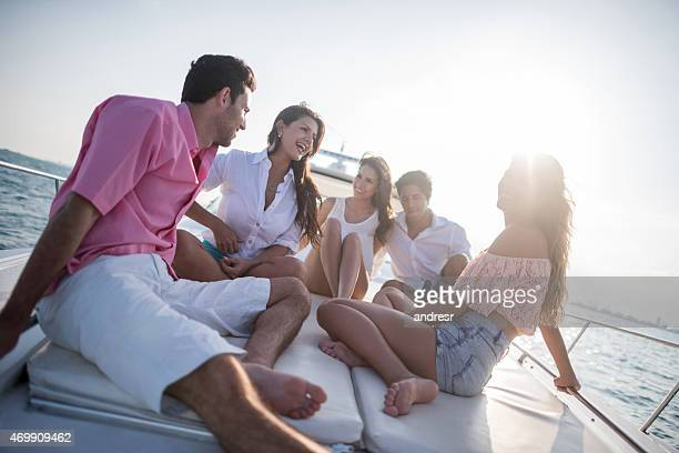 Group of friends sailing on a yacht