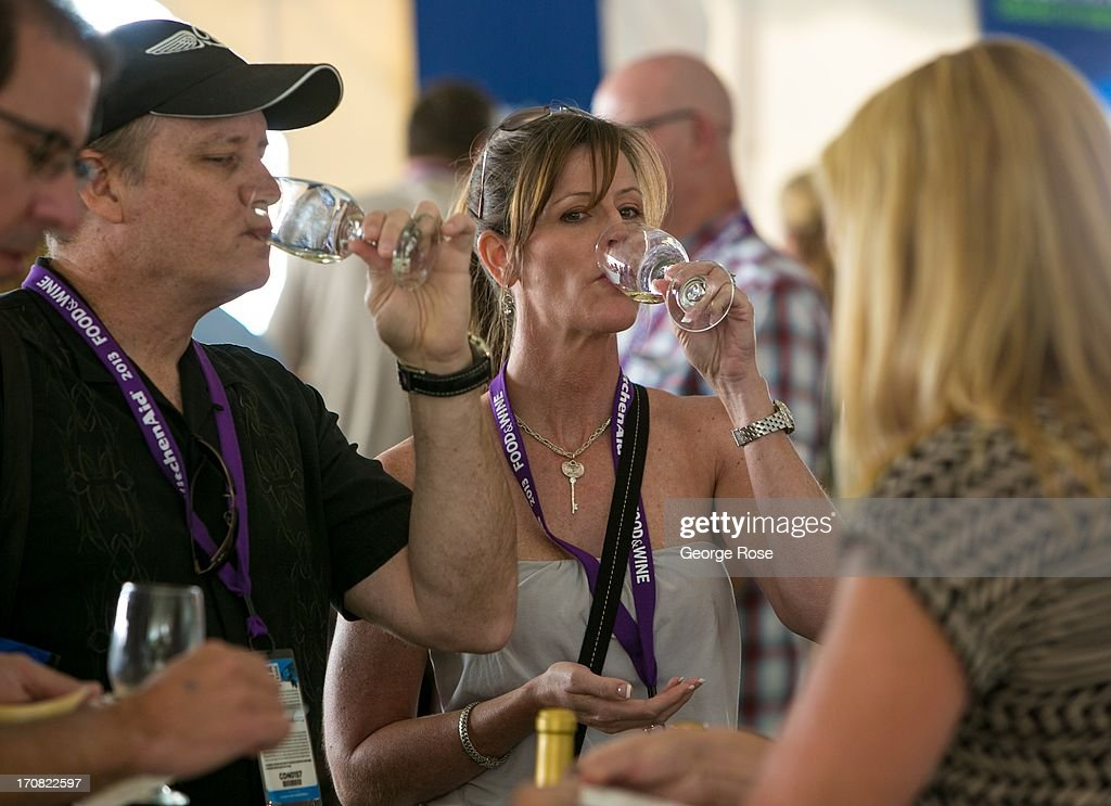 A group of friends sample a taste of wine during the Aspen Food Wine Classic Grand Tastings on June 14 in Aspen Colorado The 31st Annual Food Wine...