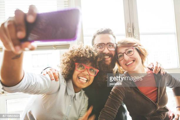 Group of friends selfie at home
