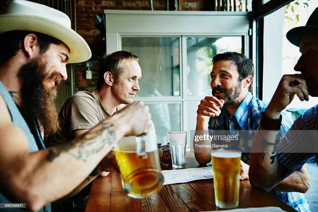 Group of friends sharing drinks in restaurant : Stock Photo