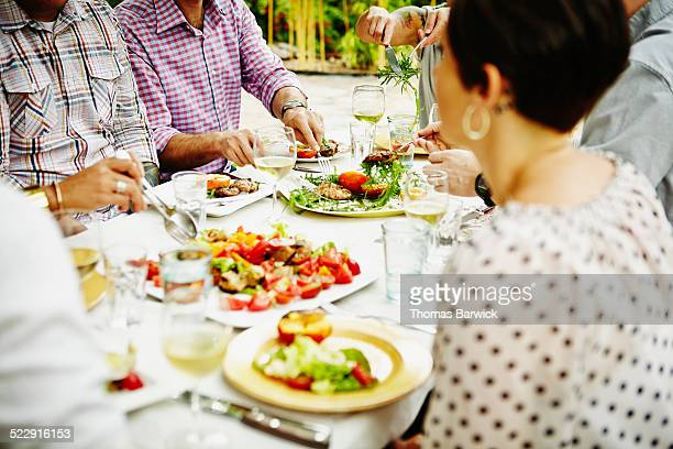 Group of friends sharing food during dinner party