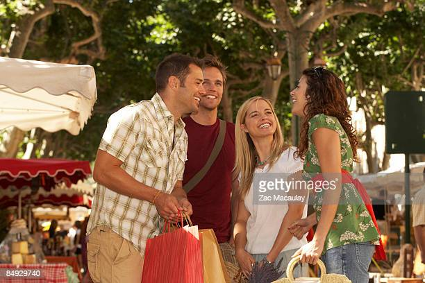 Group of friends shopping in market