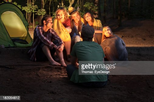 Group of Friends Sitting Around a  Campfire
