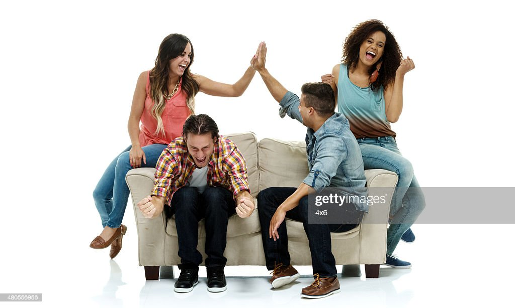 Group of friends sitting on sofa : Stock Photo