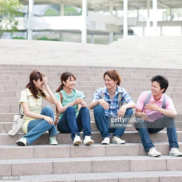 Group Of Friends Sitting On Staircase