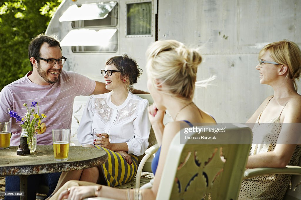 Group of friends sitting outside having drinks : Stock Photo