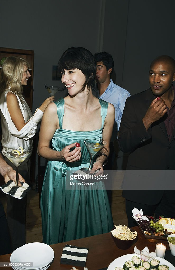 Group of friends socializing at cocktail party : Stock Photo