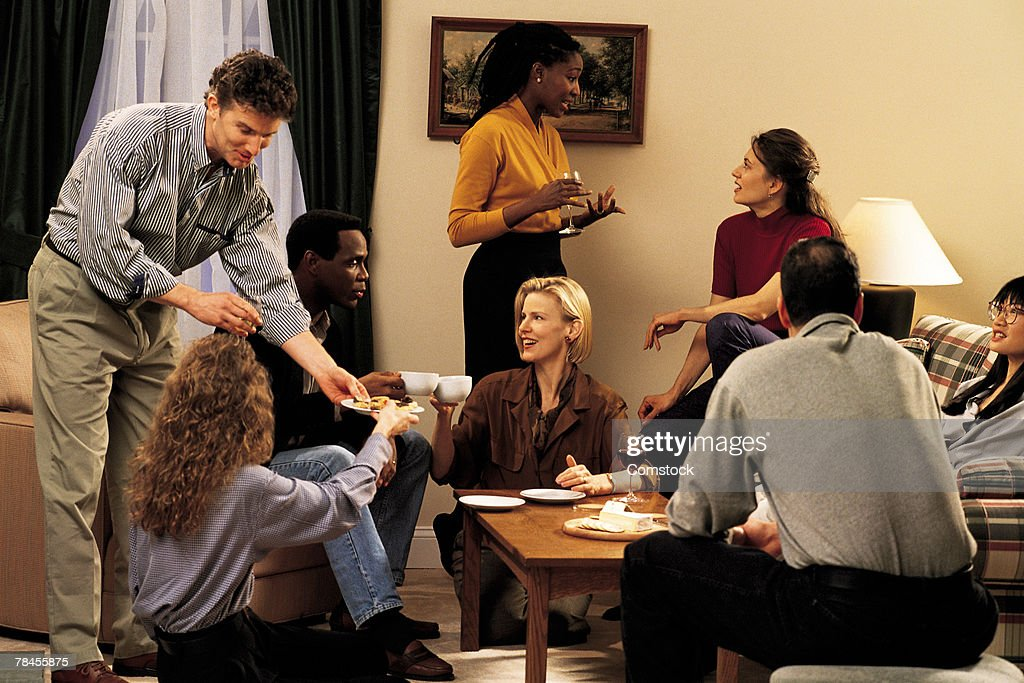 Group of friends socializing in living room
