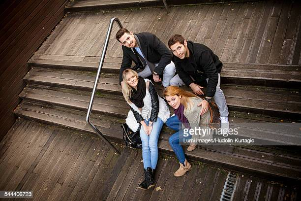 Group of friends taking a break on staircase