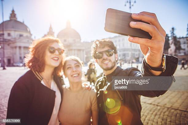 Group of friends taking a selfie in Rome
