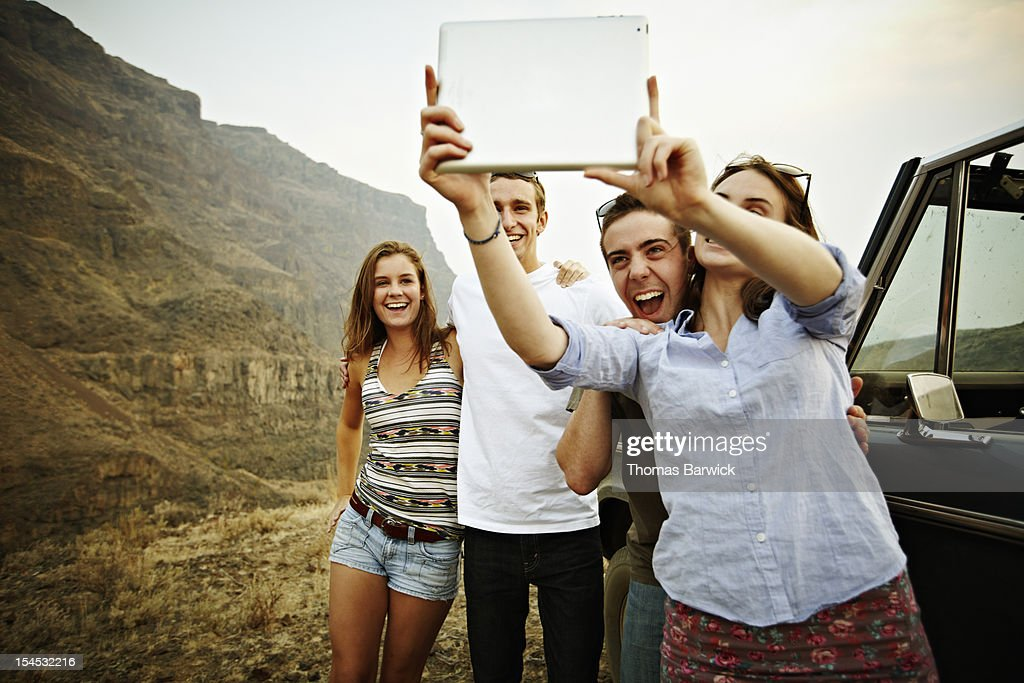 Group of friends taking photo with digital tablet : Stock Photo