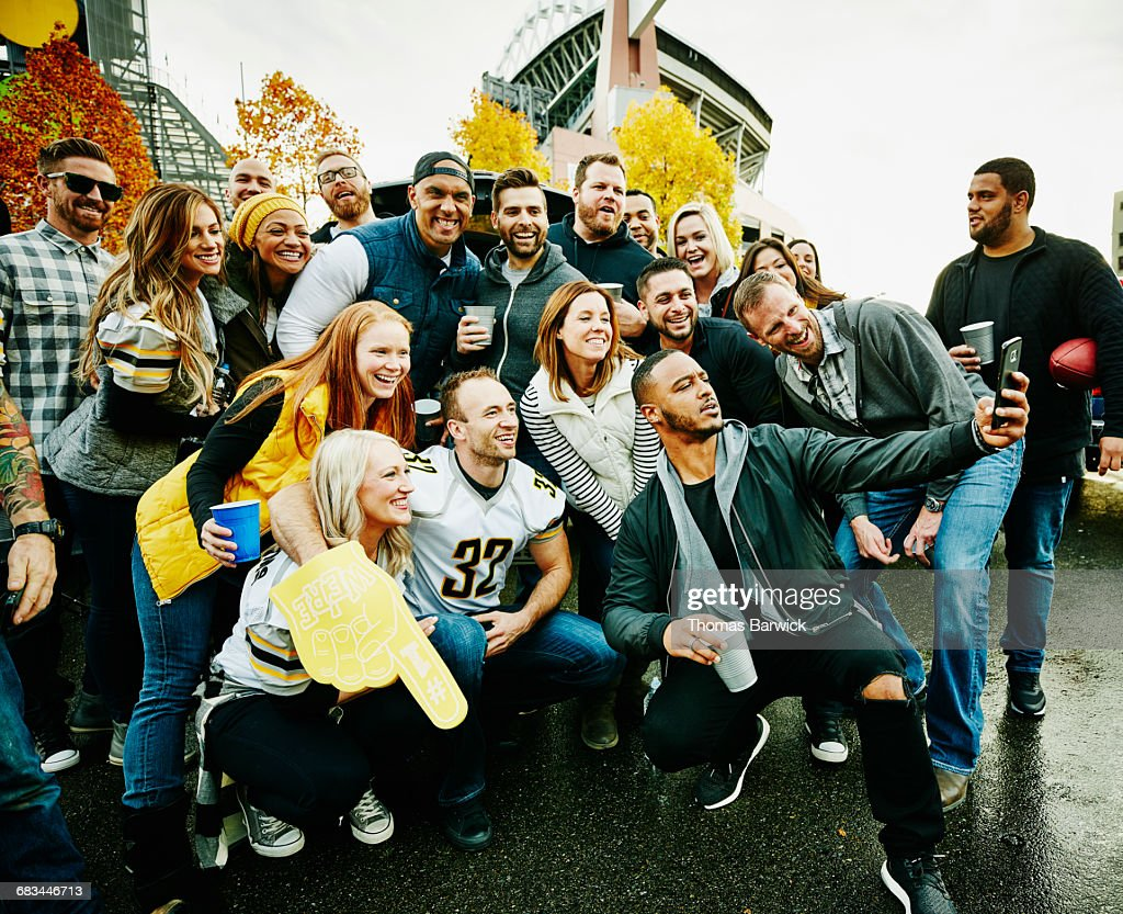 Group of friends taking selfie at tailgating party : Stock Photo