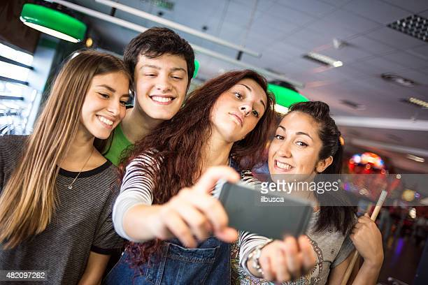 Group of friends taking selfie at the pool hall