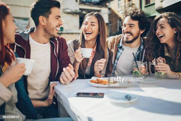 Group of friends talking in a restaurant