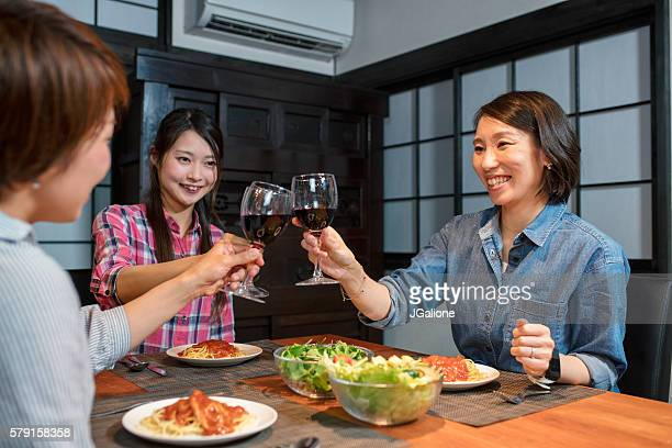 Group of friends toasting at a dinner party