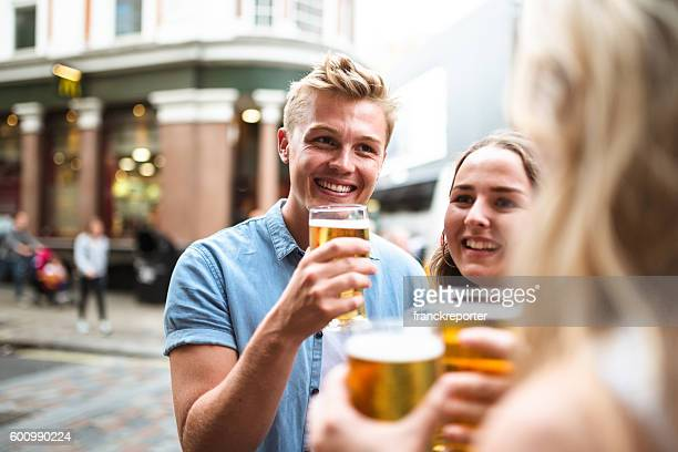 group of friends toasting with drinks for the oktoberfest