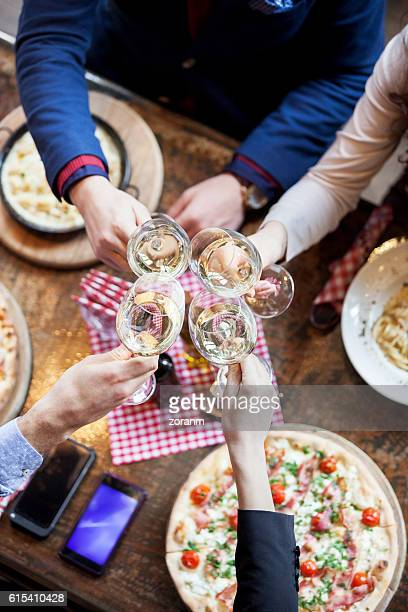 Group of friends toasting with wine