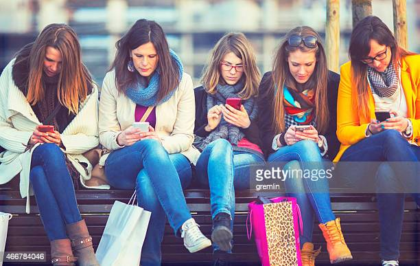 Group of friends using smart phones, internet, ignorance