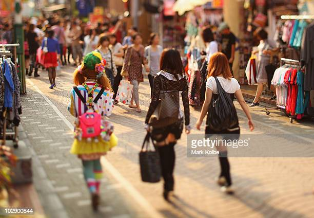 A group of friends walk along Takeshita Street in Harajuku on May 25 2010 in Tokyo Japan Takeshita Street is pedestrianonly shopping strip popular...