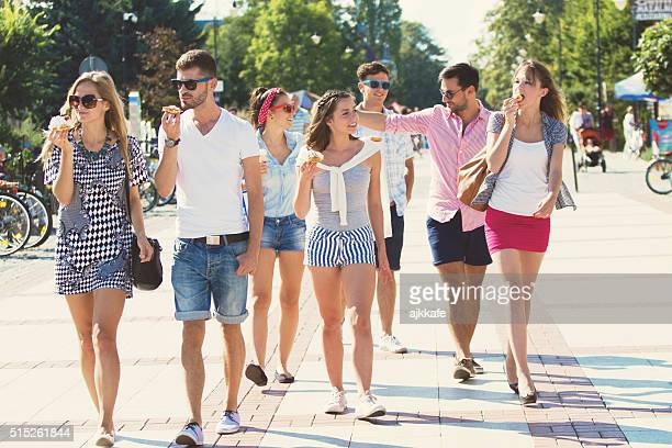 Group of friends walking and eating