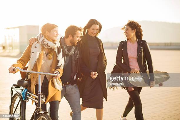 Group of friends walking and sharing happy moments.