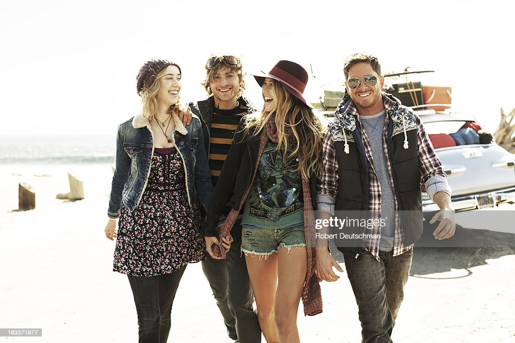 A group of friends walking at the beach. : Stock Photo