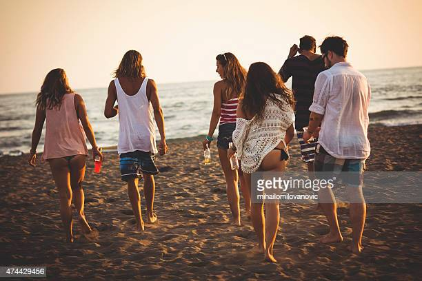 Group of friends walking at the beach
