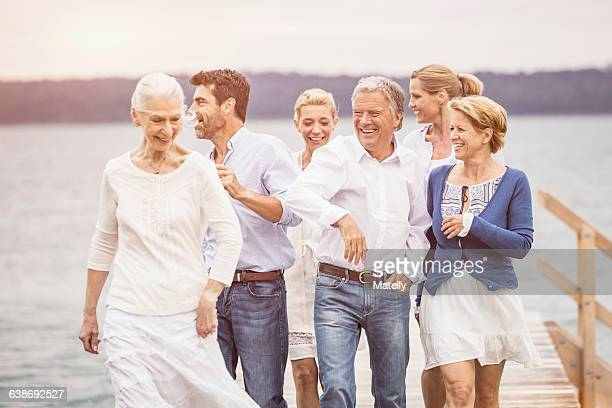 Group of friends walking together on pier