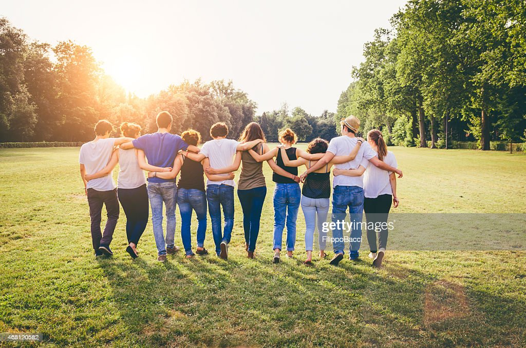 Group Of Friends Walking Together : Stock Photo