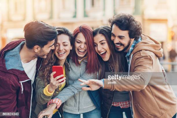Group of friends watching and laughing