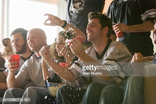 Group of friends watching sports on tv : Stock Photo