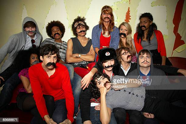 Group of friends wearing silly moustaches