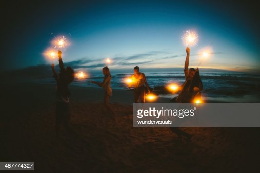 Group of friends with fireworks