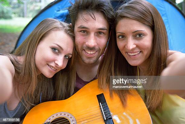 Group of friends with guitar take their own selfie